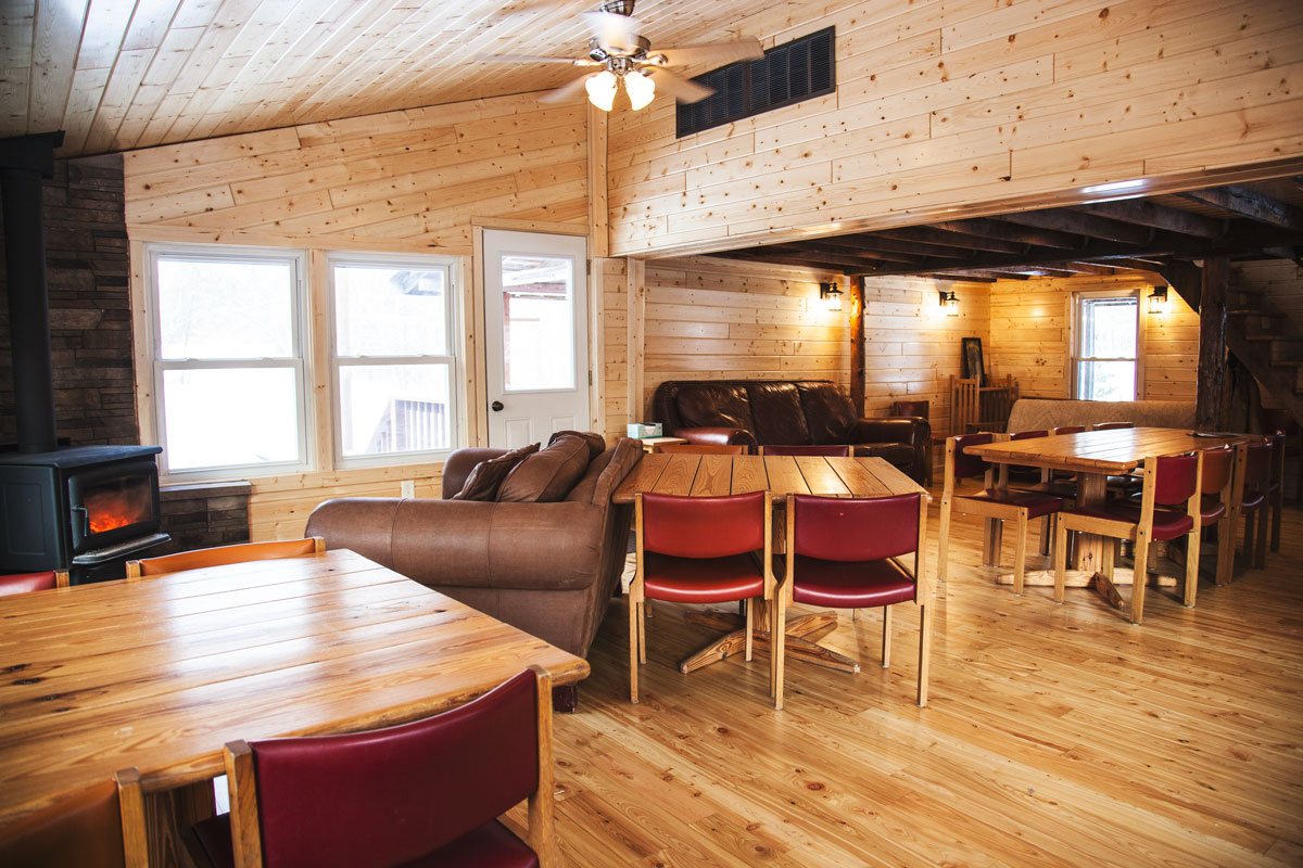family cabins group cabins retreat cabins Windy Hill Farm House Knotty Pine Design Living Area