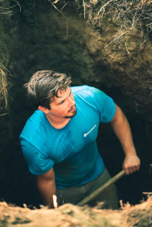 Caleb Klawitter digs a pit