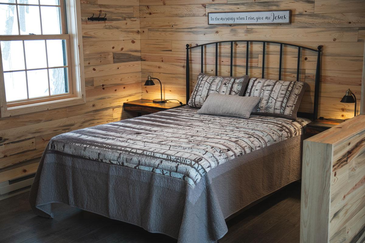 bedroom in the whisper prayer cabin